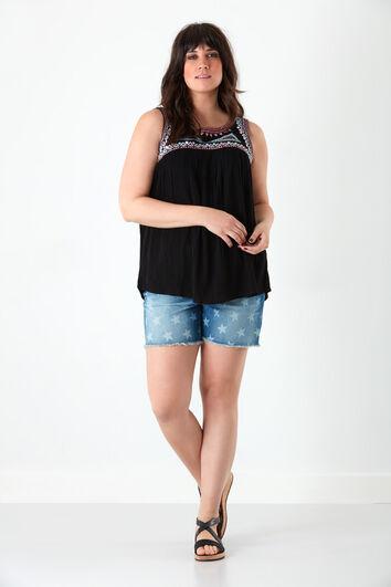 Short en jean avec motif imprimé