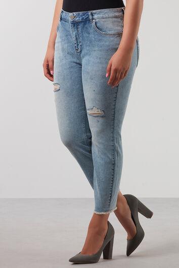 Jean jambes slim effilochées