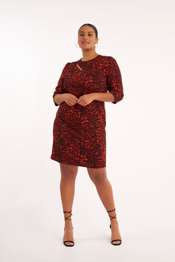 Robe moulante avec des éléments décoratifs et un imprimé léopard